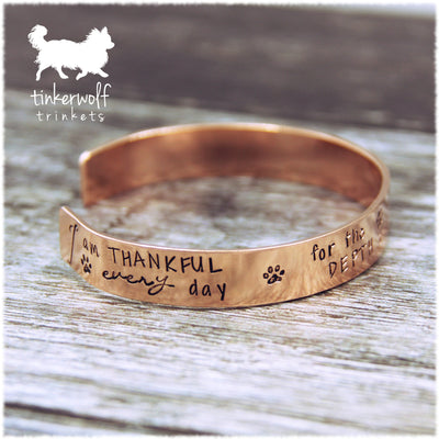 Extraordinary nature of the canine soul copper cuff