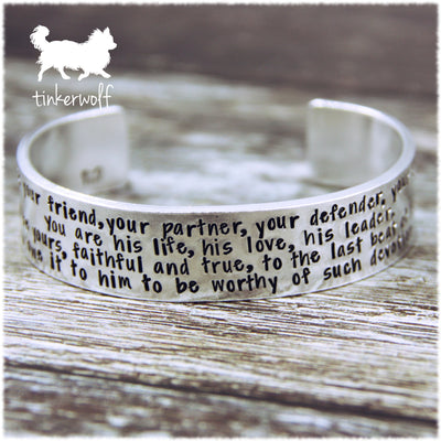 He is your friend, your partner, your defender, your dog cuff