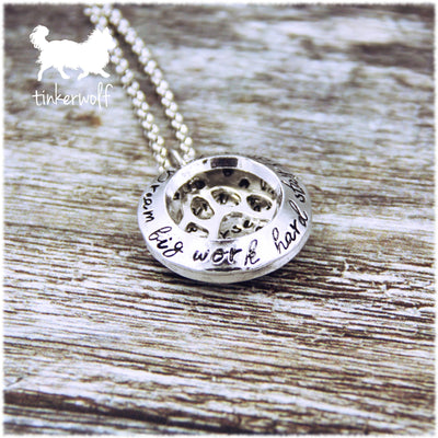 Surround yourself with lots of dogs clamshell pendant