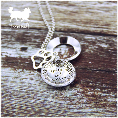 Paws and names clamshell pendant