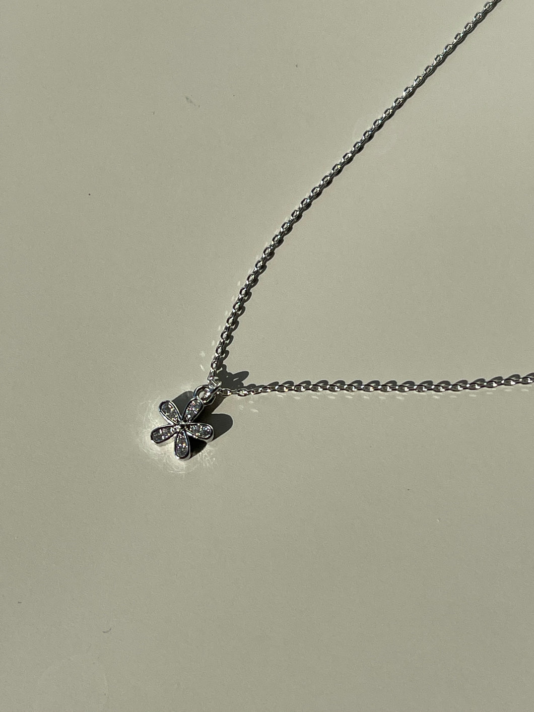 Mini Flower Charm Necklace In Silver