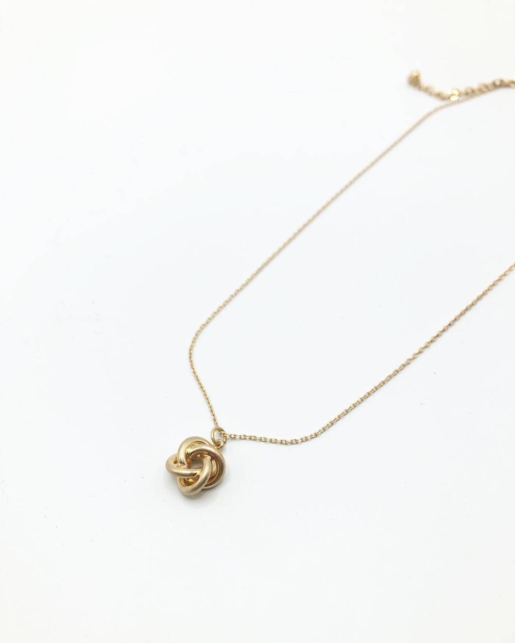 Knot Charm Necklace In Gold