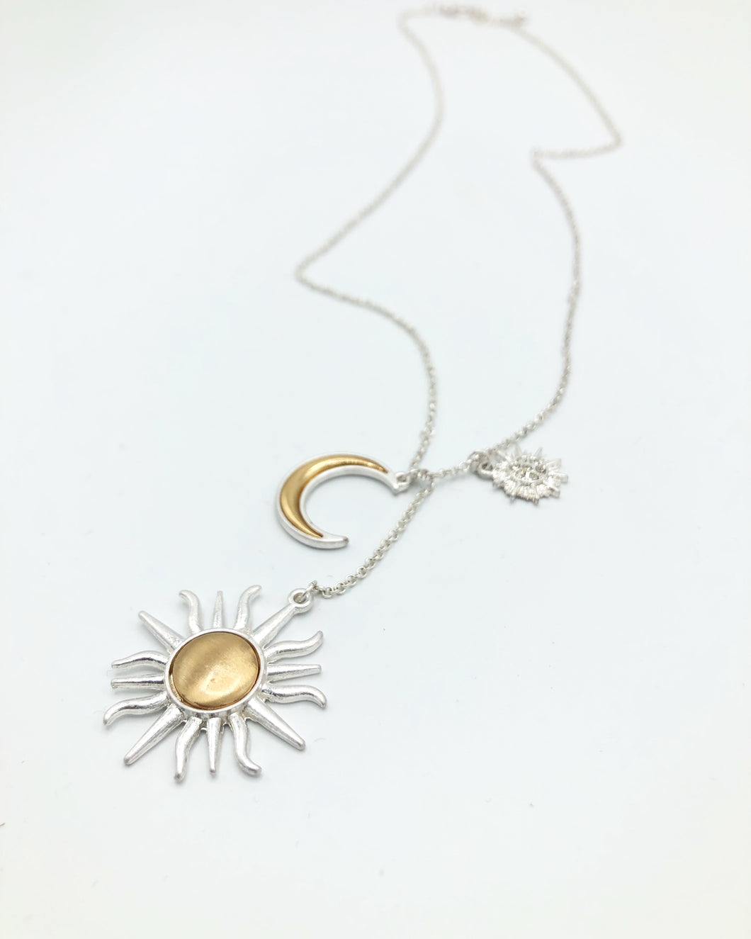 Sun Moon And Charm Necklace In Matte Silver
