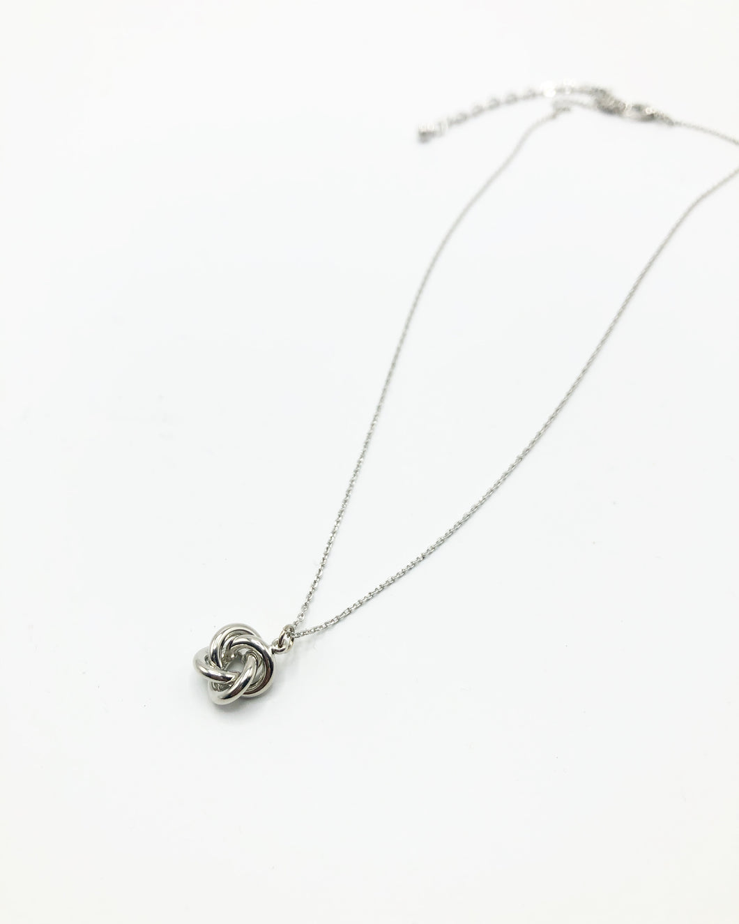 Knot Charm Necklace In Silver