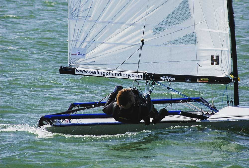 George Smith sailing his RS600 on the trapeze - sailing chandlery