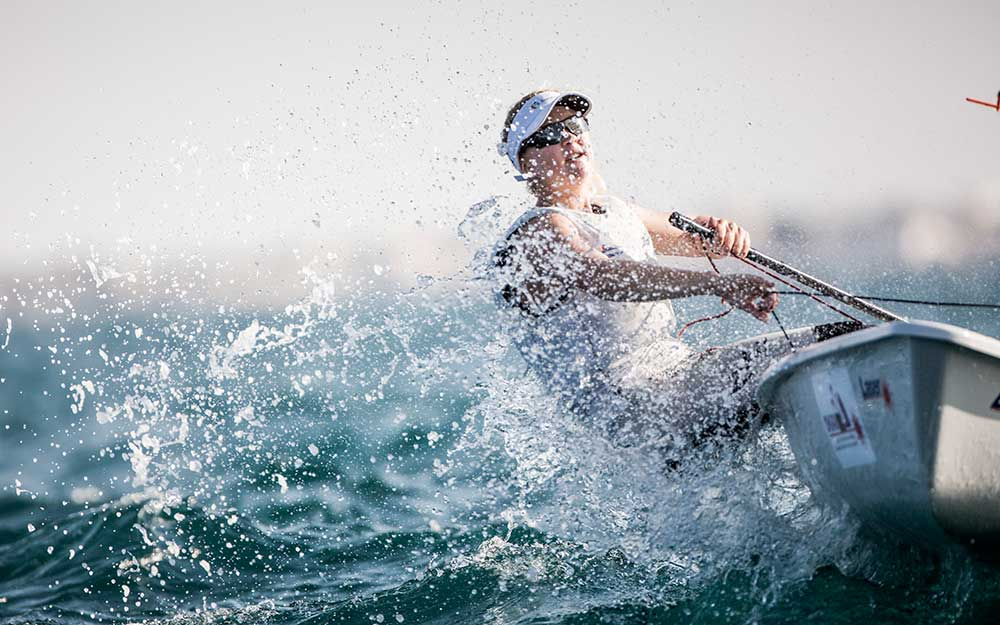Safety on the Water - Lady sailing Laser Radial wearing Zhik sailing clothing