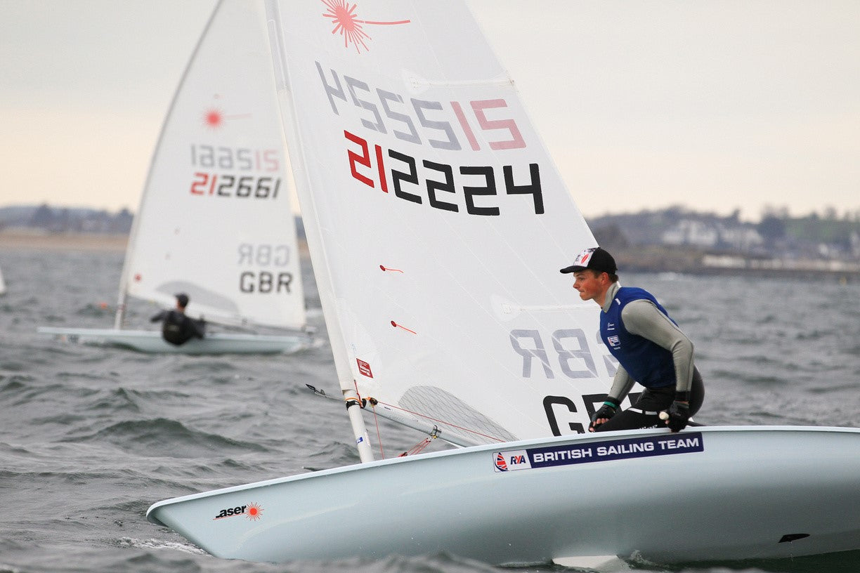 Sam Whaley during a roll tack sailing his Laser sailing dinghy