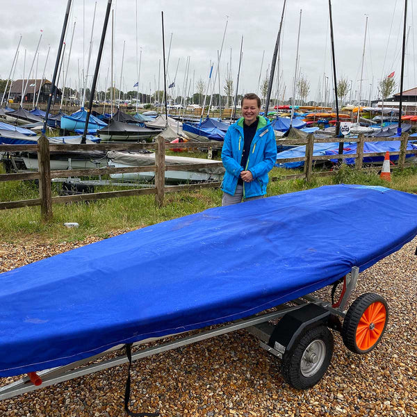 Handover of a new Laser Sailing Dinghy to a happy customer - Sailing Chandlery