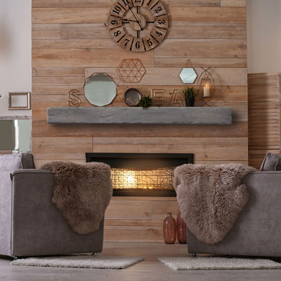 A grey rustic floating matel installed on a reclaimed wood wall.