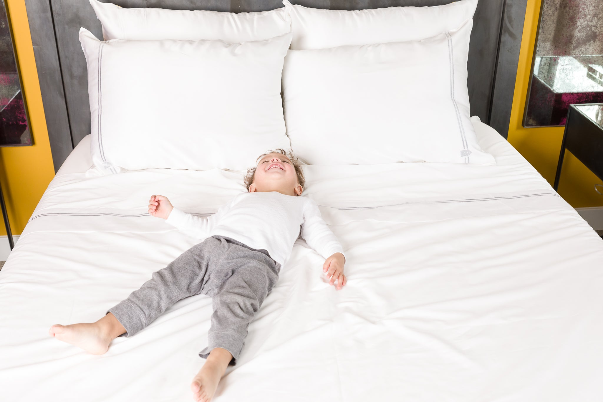 Luxury bedding from Mismatch - boy laying on mulberry silk pillowcase with cotton sheets that match.  Mixing Fabrics, Matching Style. Beauty benefits- anti-aging, health, reduce wrinkles, natural skincare, hypoallergenic, curly natural hair