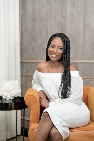 Mismatch Bedding - Anisha Rice, Founder of Mismatch.  Silk pillowcases with matching cotton sheets.  African American woman with natural hair in braids with extensions.  Promoting silk pillowcases with matching cotton sheets for all of the beauty benefits including moisturizing hair and skin, anti-aging, anti-breakage, promoting hair growth for hair and facial hair like beards and eyelashes