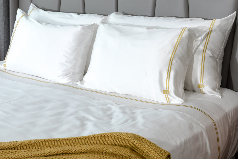 Got Silk? Luxury bedding by Mismatch.  Silk pillowcase with matching cotton sheets.  White with gold embroidery. Great for natural beauty, reduce the appearance of wrinkles, keep moisture in your hair and skin, reduce hair breakage, and healthy beard.