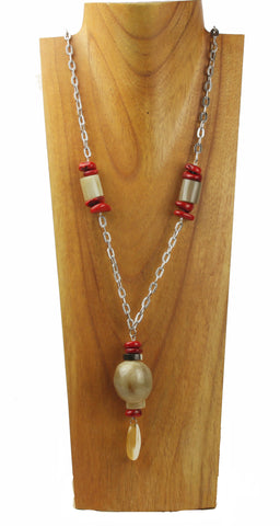 Horn necklace with coral scales.