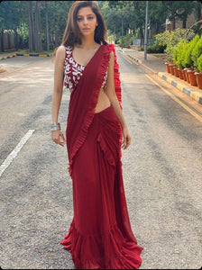 Actress Vedhika in a maroon stitched saree Chhavvi Aggarwal