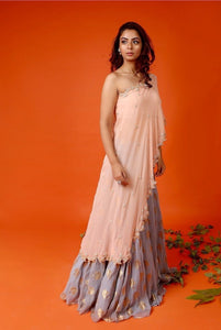 One shoulder cape with lehenga skirt Chhavvi Aggarwal