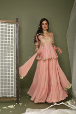 Load image into Gallery viewer, Peach peplum top with sharara and dupatta Chhavvi Aggarwal