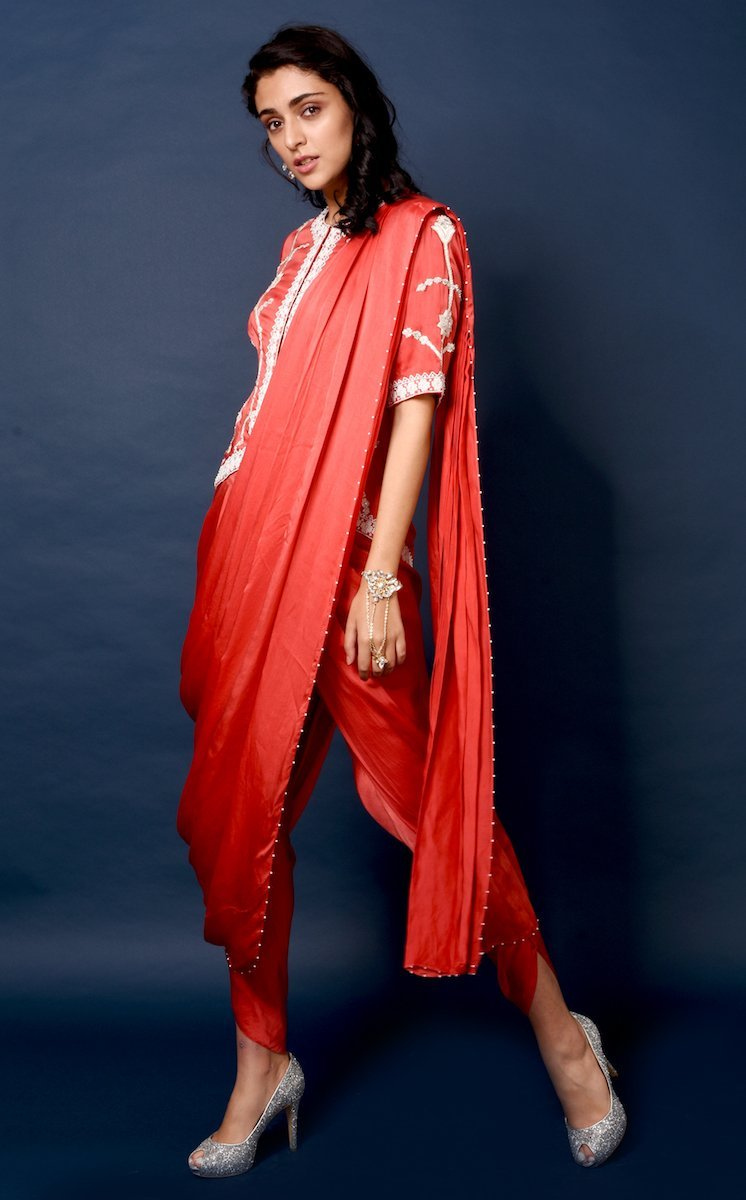 Red embroidered jacket with draped dhoti sari Chhavvi Aggarwal