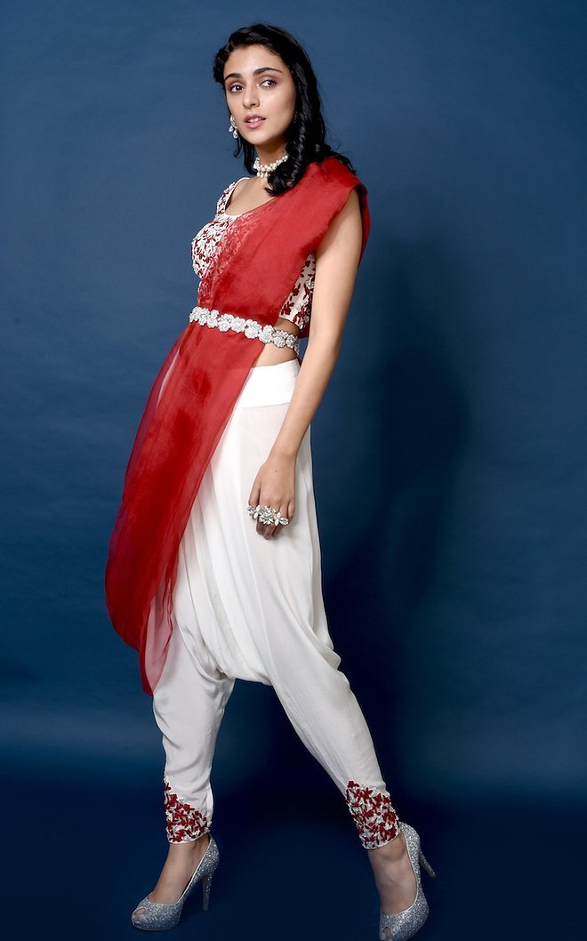 embroidered crop blouse with dhoti pants, organza drape and embroidered belt. Chhavvi Aggarwal
