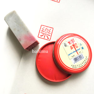 Red ink paste in metal casing for stone seals