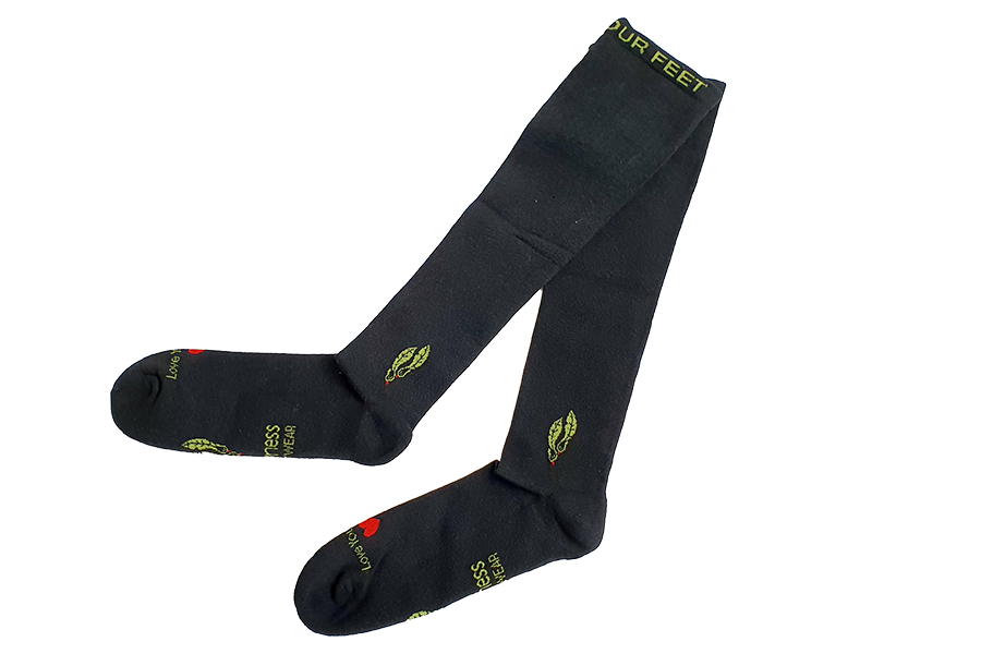 Charcoal bamboo compression socks on trans background legs