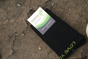 Charcoal bamboo compression socks - label on rock