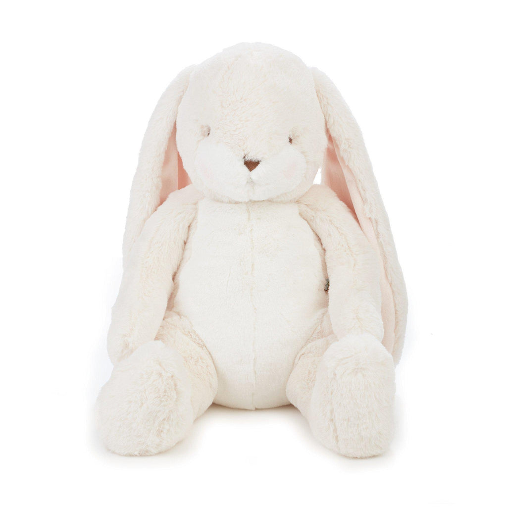 Big Nibble Bunny, a cream-colored large, cute bunny stuffed animal on a white background.