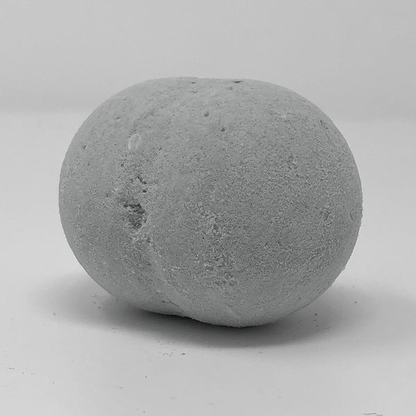 round light brown bath bomb