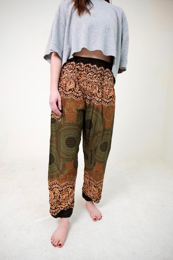 Front-view mandala elephant pants in olive green with model and white background-fullsize image