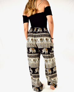 Rear-view aztec elephant pants in black with model and white background-full size image