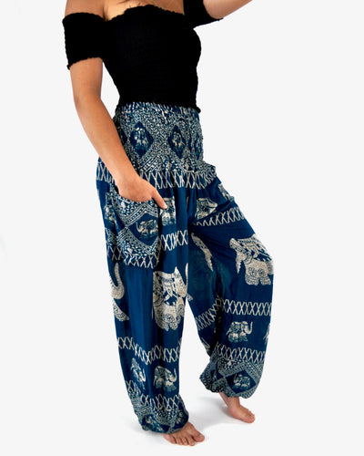 Front-view diamond elephant pants in teal with model and white background-fullsize image