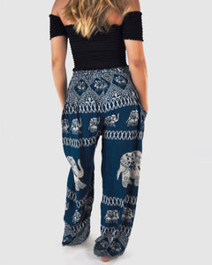 Rear-view diamond elephant pants in teal with model and white background-fullsize image