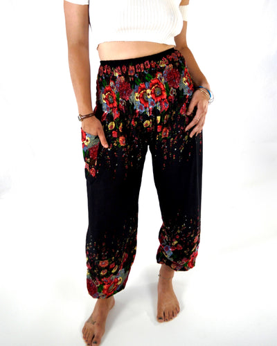 Front-view floral elephant pants in black with model and white background-fullsize image