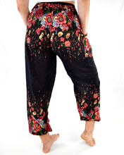 Load image into Gallery viewer, Rear-view floral elephant pants in black with model and white background-fullsize image