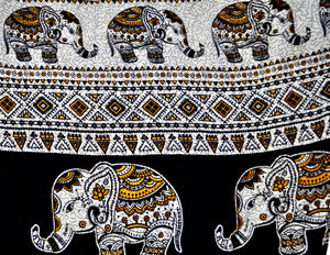 Close-up on aztec elephant pants pattern