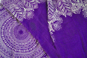 Close-up on dream catcher elephant pants pattern in purple