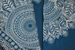 Close-up on dream catcher elephant pants pattern in teal