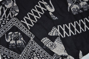Close-up on diamond elephant pants pattern in black