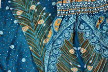 Load image into Gallery viewer, Close-up on peacock elephant pants pattern in teal