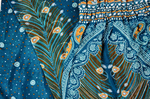 Close-up on peacock elephant pants pattern in teal