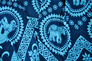 Close-up on tribal elephant pants pattern in teal
