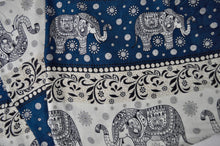 Load image into Gallery viewer, Close-up on chang thai elephant pants pattern in teal