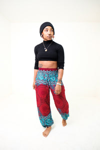 Front-view mandala elephant pants in red & teal with model and white background-fullsize image
