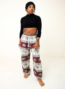 Front-view chang thai elephant pants in red with model and white background-fullsize image