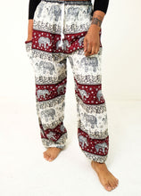 Load image into Gallery viewer, Front-view chang thai elephant pants in red with model and white background-halfsize image