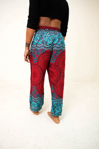 Rear-view mandala elephant pants in red & teal with model and white background-fullsize image