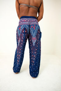 Rear-view peacock elephant pants in purple with model and white background-full-size image