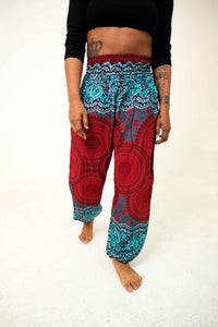 Front-view mandala elephant pants in red & teal with model and white background-halfsize image