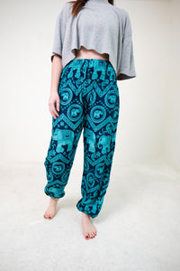 Front-view pink elephant pants in teal with model and white background-full-size image