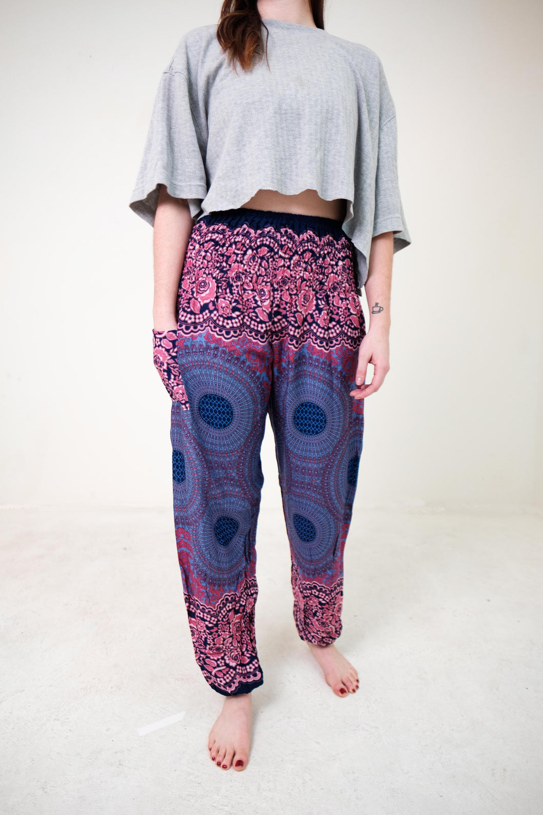 Front-view mandala elephant pants in purple with model and white background-fullsize image