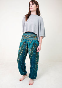 Front-view peacock elephant pants in teal with model and white background-full-size image